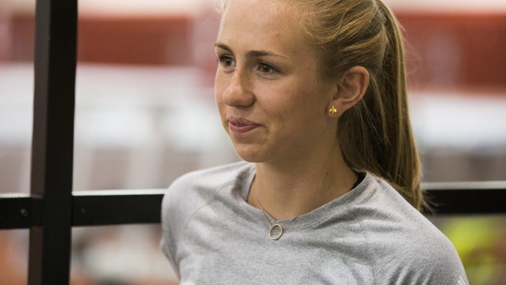 Sophomore Lexa Barrott, a distance runner, talks Friday afternoon in Gladstein Fieldhouse about her goals for the upcoming track and field season.