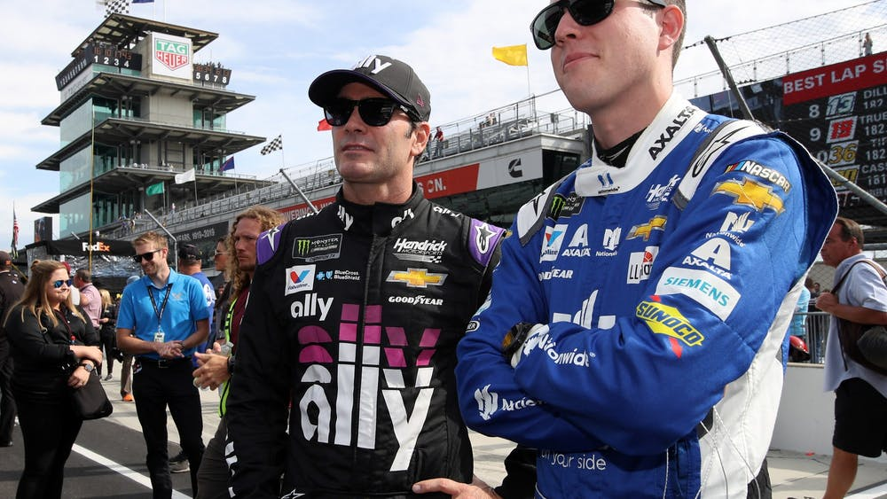 Alex Bowman, driver of the No. 88 Nationwide Chevrolet, talks with Jimmie Johnson, driver of the No. 48 Ally Chevrolet, during qualifying for the NASCAR Cup Series Big Machine Vodka 400 at the Brickyard at Indianapolis Motor Speedway on Sept. 8, 2019, in Indianapolis. Bowman, who replaced Dale Earnhardt Jr. after his retirement, will drive the No. 48 next season for Hendrick Motorsports.