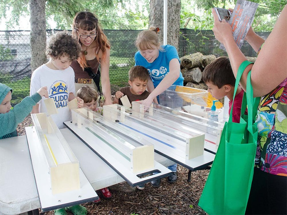 Event attendees participate in a madagascar hissing cockroach race during Bug Fest at the Hilltop Garden & Nature Center on Saturday. The Bug Fest's mission is to educate the public about insect and spider biology, and was open to all ages.