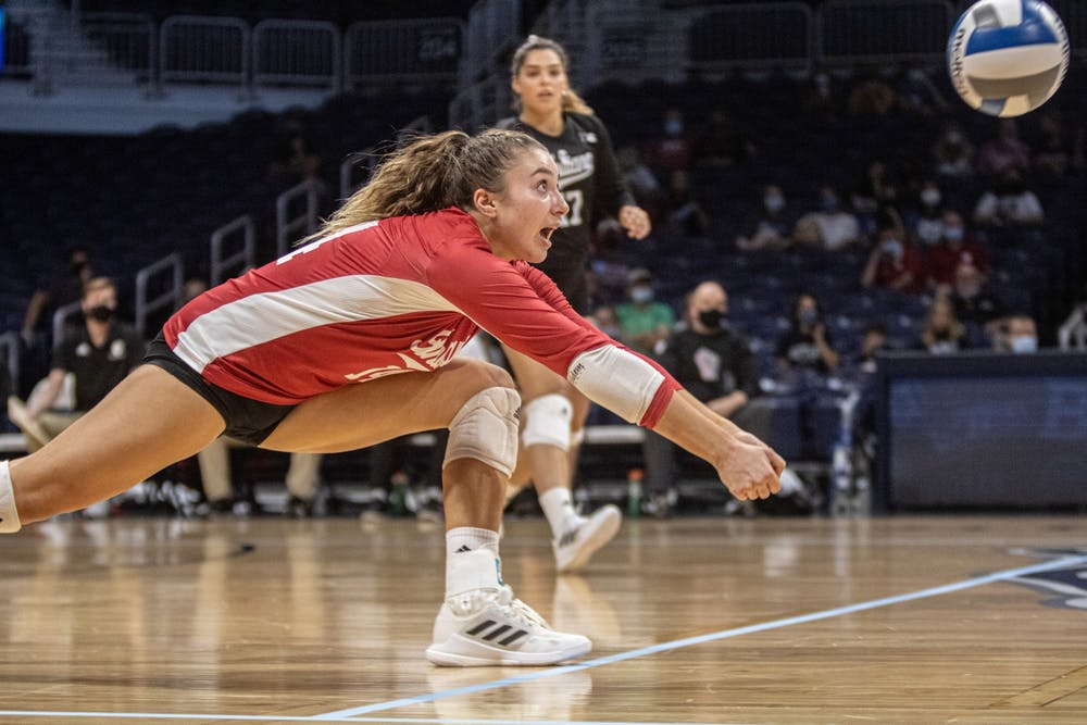 <p>Junior Haley Armstrong goes for a bump hit against Butler on Aug. 29, 2021, at Hinkle Fieldhouse. Indiana volleyball lost its three matches at the Georgia Tech Classic. </p>