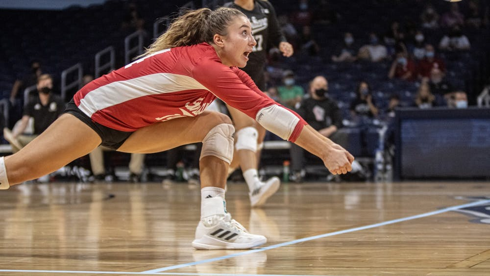 Junior Haley Armstrong goes for a bump hit against Butler on Aug. 29, 2021, at Hinkle Fieldhouse. Indiana volleyball lost its three matches at the Georgia Tech Classic.