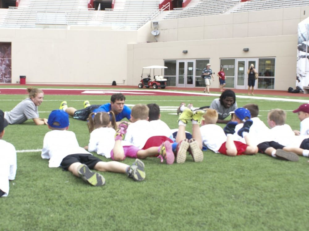 Andrew Luck talks with children during the Change the Play event Tuesday in Bloomington.