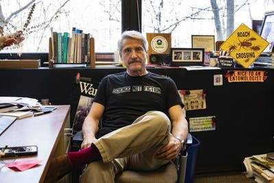 Clinical associate professor Marc Lame sits at his desk Jan. 22 in the School of Public and Environmental Affairs. Lame is a 20-year faculty member and holds degrees in agriculture, entomology, and public administration.