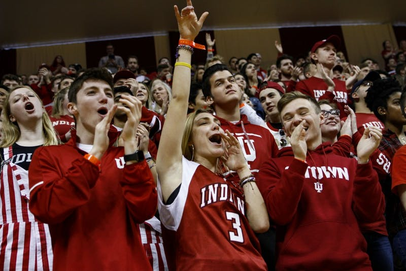 Students cheer on the IU basketball team arriving on the court March 23 at Simon Skjodt Assembly Hall. Butler University's Joey Brunk is transferring to IU.