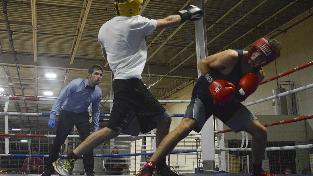Then-senior Tommy Butler, left, punches his fist towards his opponent during a practice spar in November 2016 at B-Town Boxing. B-Town Boxing will organize an event next week with former world champion boxer Lamon Brewster.