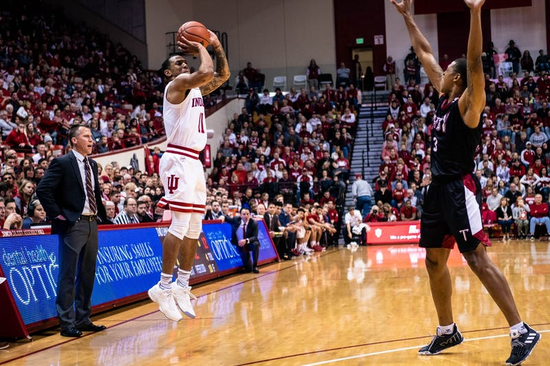 Senior Devonte Green sets up to shoot the ball against Troy University on Nov. 16 at Simon Skjodt Assembly Hall. This was Green's first game of the season, playing 19 minutes.
