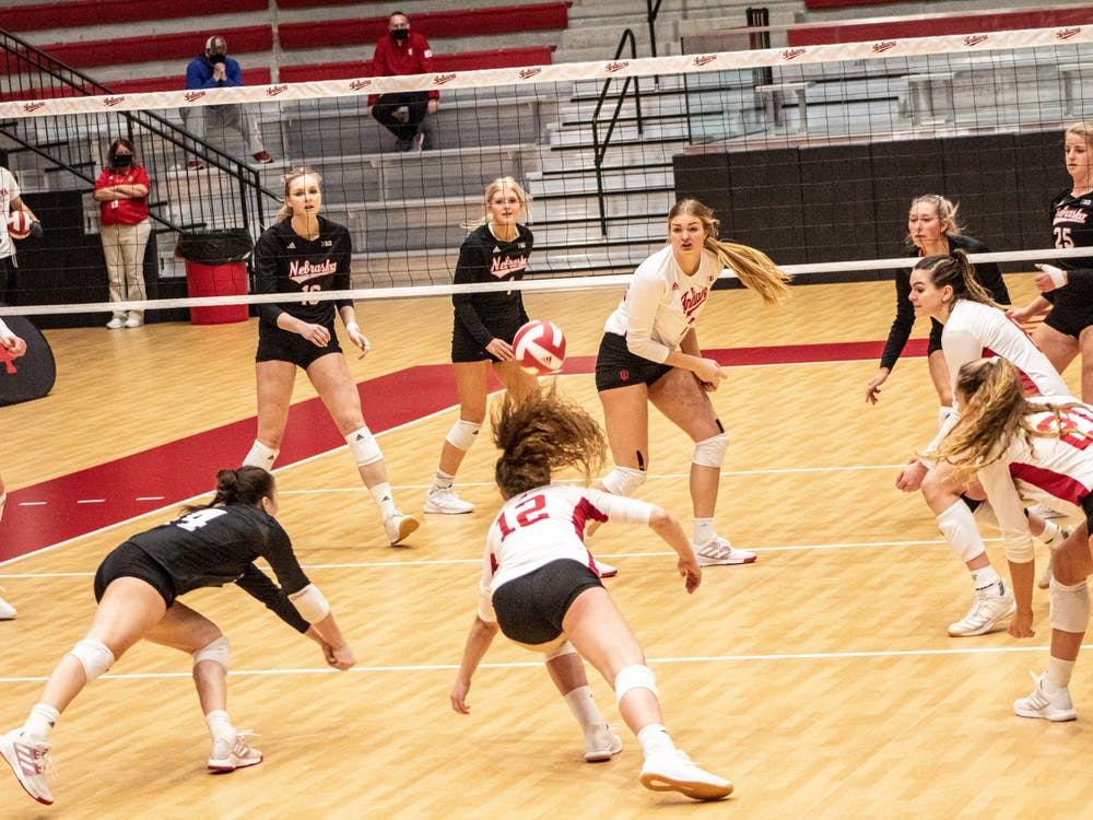 The Hoosiers dive for the ball against Nebraska on Jan. 23 in Wilkinson Hall. IU lost in three sets to Nebraska for the second day in a row.