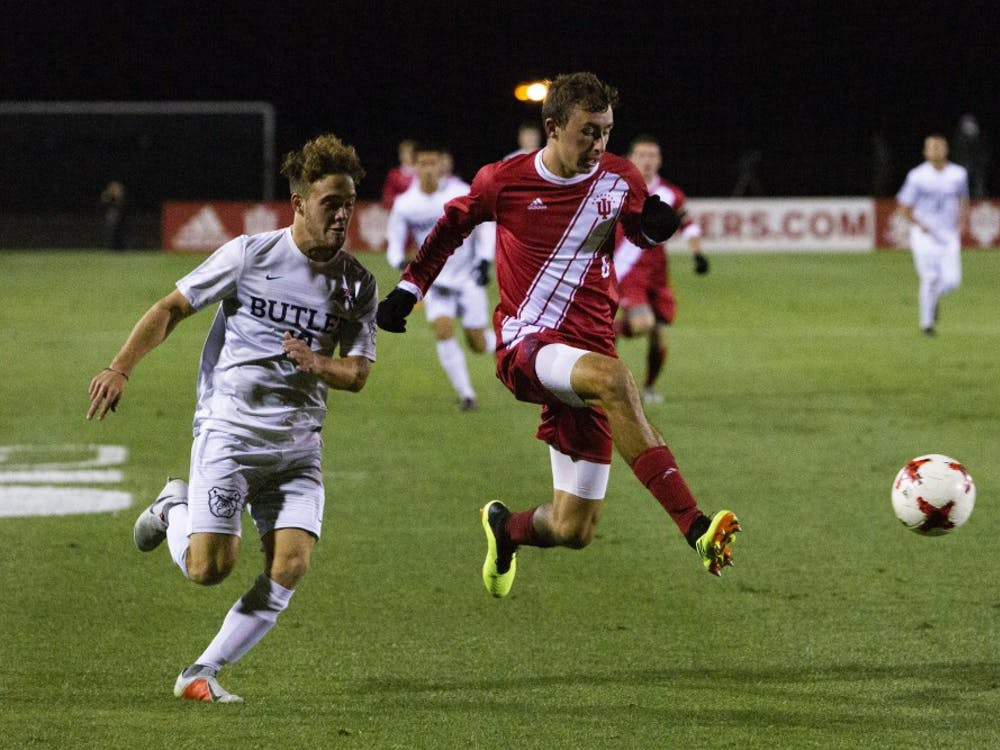 Freshman defender Jack Maher holds off junior Butler midfielder Adam Burch while attempting to win the ball Oct. 16 at Bill Armstrong Stadium. IU defeated Butler, 3-0.