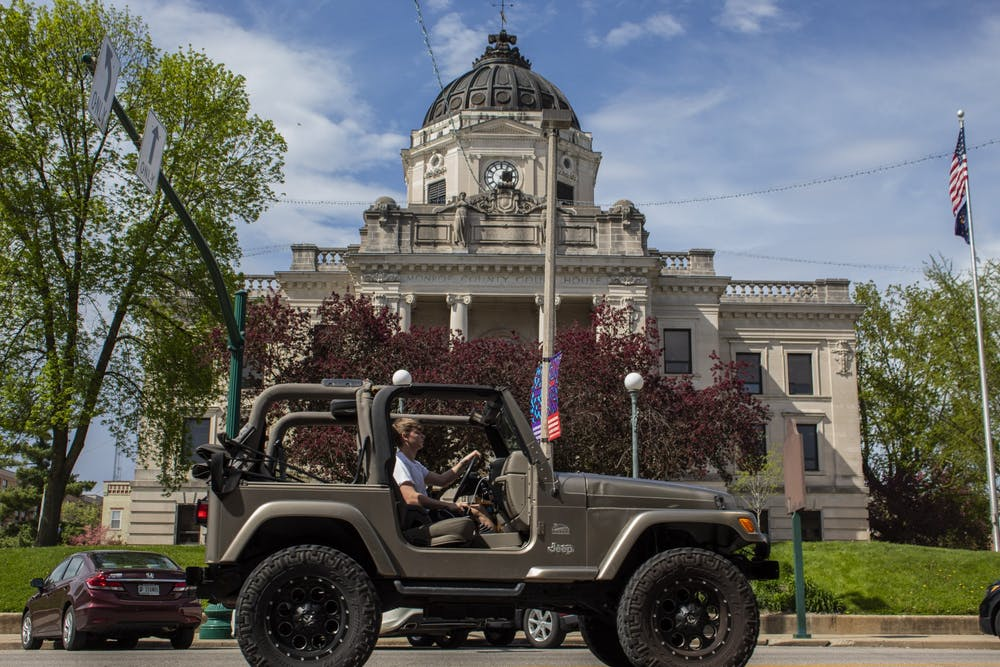 <p>A car drives April 22, 2019, past the Monroe County Courthouse. Jennifer Schepers, director of the Paul H. O'Neill School of Public and Environmental Affairs Career Hub, said students in the school are supposed to have 120 hours of internship credit through the school in order to graduate.</p>
