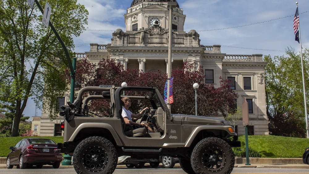 A car drives April 22, 2019, past the Monroe County Courthouse. Jennifer Schepers, director of the Paul H. O'Neill School of Public and Environmental Affairs Career Hub, said students in the school are supposed to have 120 hours of internship credit through the school in order to graduate.