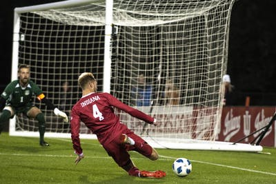Junior A.J. Palazzolo attempts to save a ball from going out of bounds against the University of Evansville on Oct. 22 at Bill Armstrong Stadium. The IU men's soccer team earned its second-straight Big Ten Tournament title on Sunday, earning a top five seed in the NCAA Tournament on Monday.