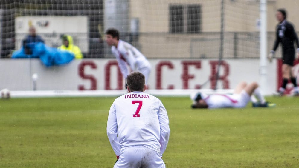 Freshman Victor Bezerra rests on his knees after IU was eliminated from the NCAA Tournament by the University of California, Santa Barbara on Dec. 1 at Bill Armstrong Stadium. UCSB slotted the ball past freshman IU goalkeeper Roman Celentano in the second period of overtime.
