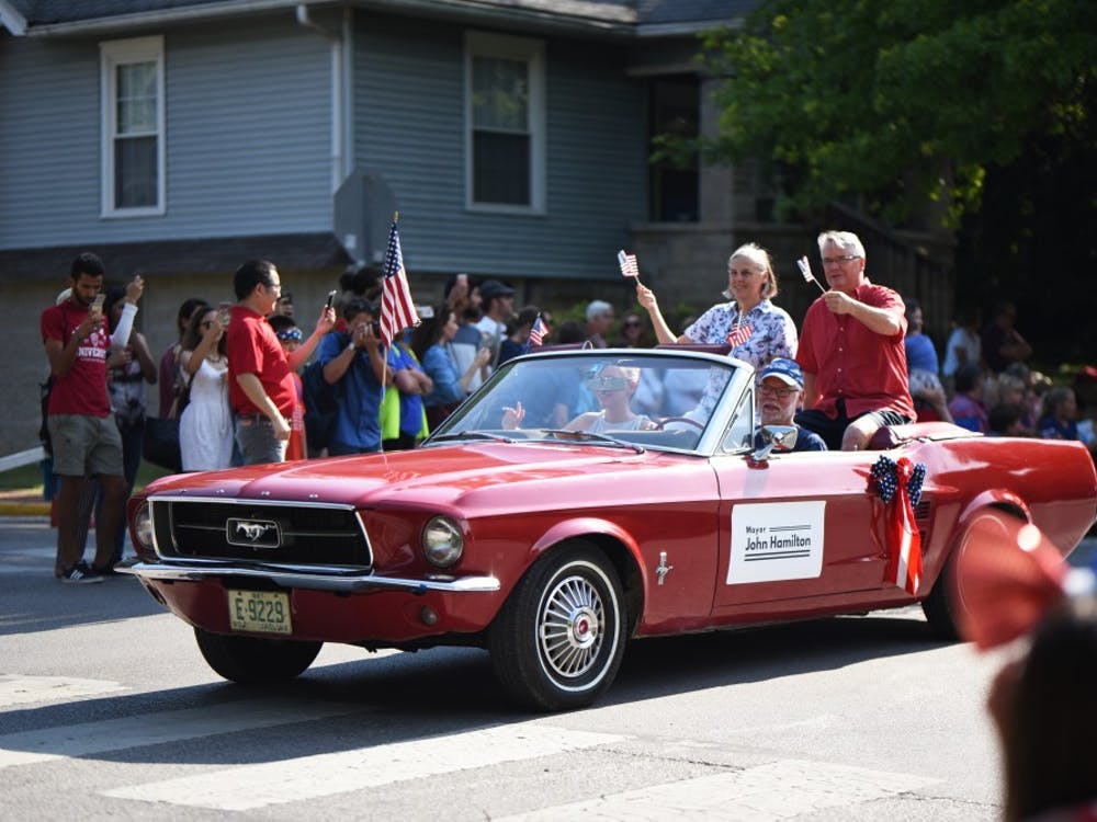 Bloomington's mayor John Hamilton and his wife start the 4th of July parade on Tuesday. The parade attracted hundreds of visitors to sit and watch different floats parade downtown.