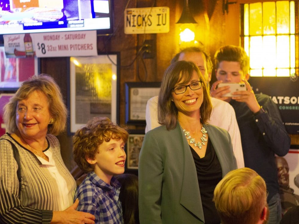 Liz Watson arrives at her vote count party to applause Tuesday, May 8, inside Nick's English Hut. Watson was declared the winner of the 9th Congressional District race by multiple news sources.
