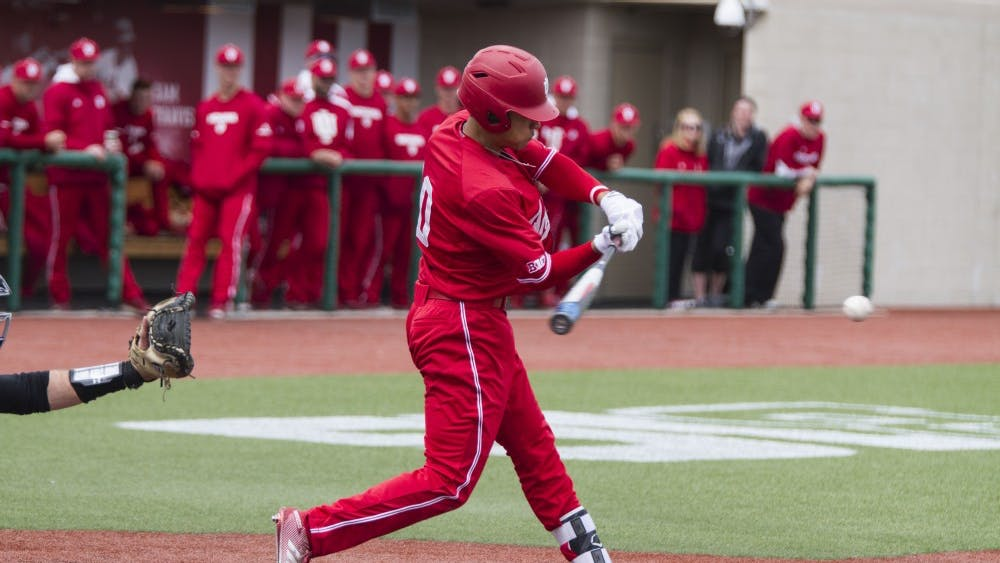 Second baseman Justin Walker hits the ball to right field. IU has won all three games against Northwestern this season.