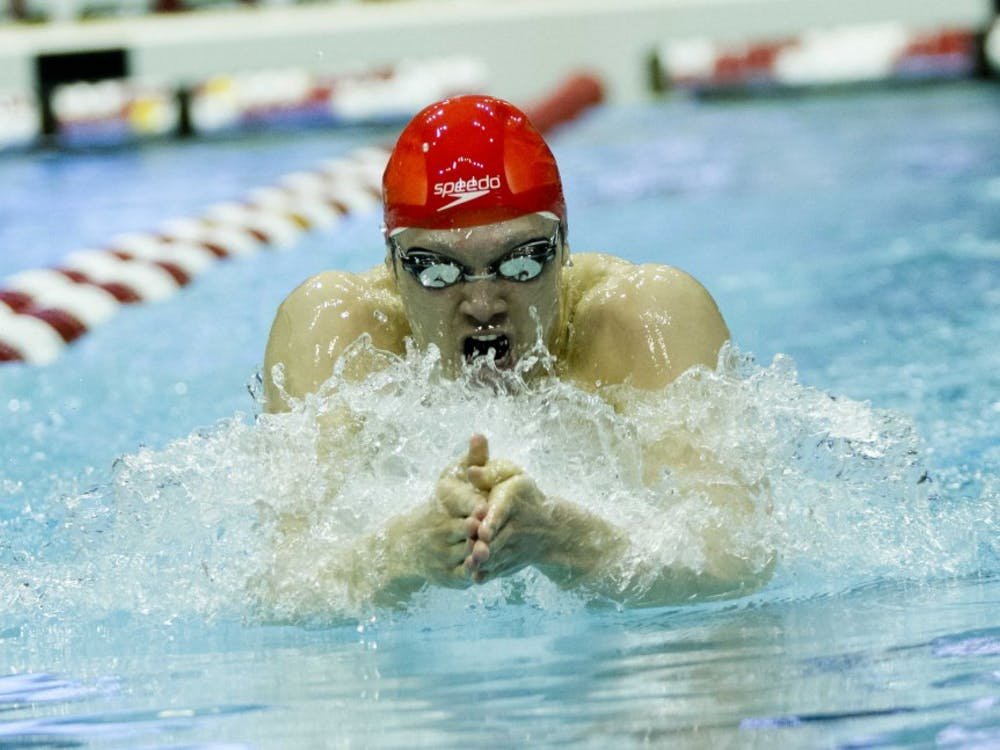 Junior Cody Miller looks towards his teamates after learning that he won the 200 Yard Breaststroke on March 3, 2012 during the Big Ten Swimming and Diving Championships at the Counsilman-Billingsley Aquatic Center