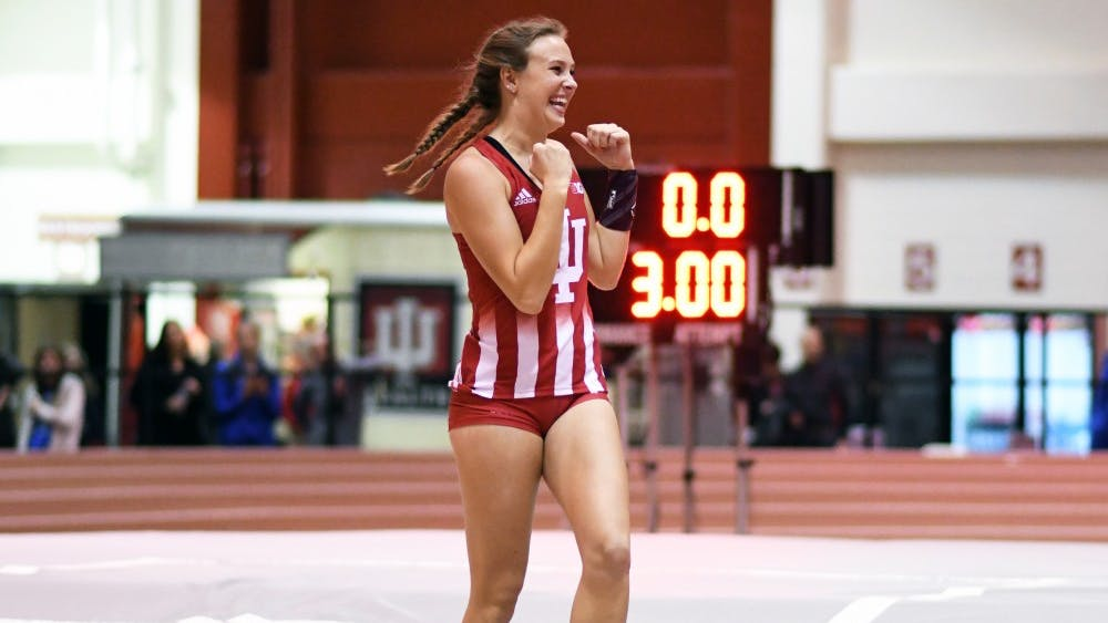 Sophomore Anna Watson celebrates during the pole vault competition at the Hoosier Open on Friday evening in Harry Gladstein Fieldhouse. Watson won the event with a jump of 4.05 meters.