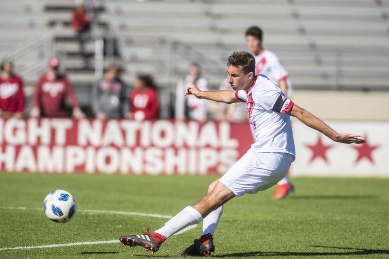 Sophomore Jack Maher plays the ball upfield during IU's win over Michigan on Oct. 13 at Bill Armstrong Stadium. Four of IU's next five matches are against Big Ten opponents.