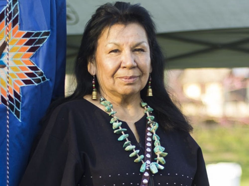 A woman at the First Nations Traditional Powwow poses at her booth April 9, 2017, in Dunn Meadow. The IU seventh annual Traditional Powwow will take place Saturday, April 7, from 10 a.m. to 10 p.m. in Dunn Meadow.