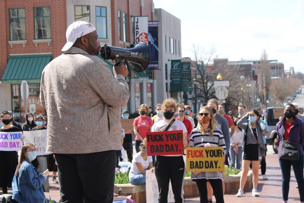 <p>Vauhxx Booker, local activist, speaks to a crowd at the Sample Gates during the Gathering Against Asian Hate. Booker was charged with misdemeanor criminal trespass, and battery resulting in moderate bodily injury, a felony, in Monroe Circuit Court on Friday.</p><p><br/></p>