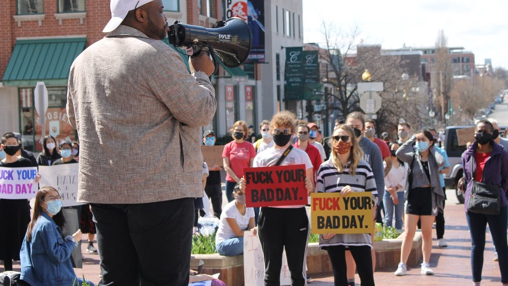 Vauhxx Booker, local activist, speaks to a crowd at the Sample Gates during the Gathering Against Asian Hate. Booker was charged with misdemeanor criminal trespass, and battery resulting in moderate bodily injury, a felony, in Monroe Circuit Court on Friday.