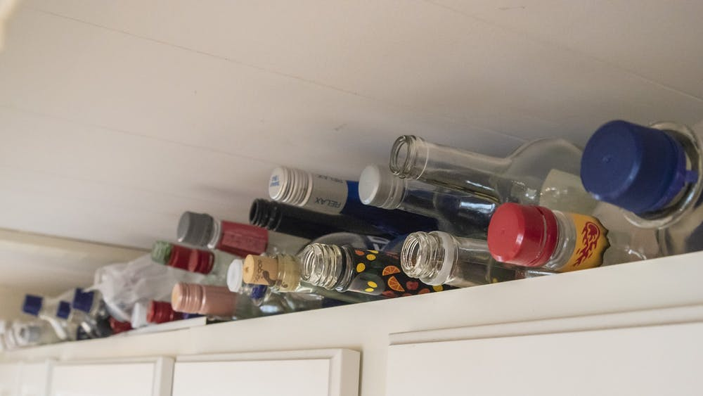 "Various alcohol bottles rest on a ""kill shelf"" Sept. 26 in a kitchen. The IU Police Department shut down three parties late Saturday night because party goers did not follow the  Gov. Eric Holcomb's stay-at-home order."