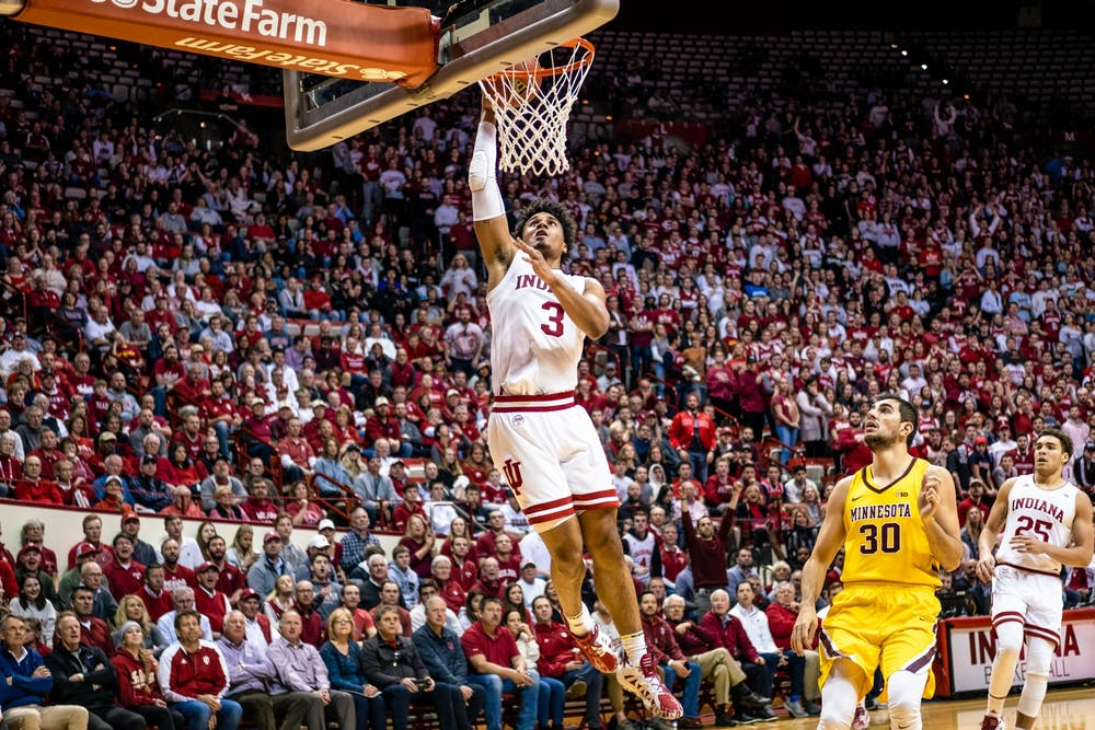 <p>Then-junior forward Justin Smith dunks the ball before Minnesota could reach him in the second half March 4 at Simon Skjodt Assembly Hall. IU won against Minnesota.</p>