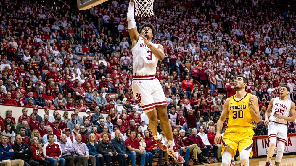 Then-junior forward Justin Smith dunks the ball before Minnesota could reach him in the second half March 4 at Simon Skjodt Assembly Hall. IU won against Minnesota.