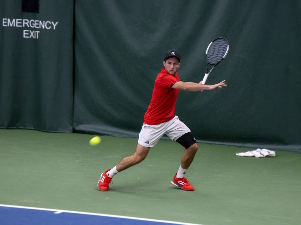 Senior Zac Brodney prepares to swing against the University of Notre Dame on Feb. 1 at the IU Tennis Center. Payam Ahmadi, Zac Brodney, Bennett Crane and William Piekarsky all joined as freshman and have stayed on the team all four seasons.