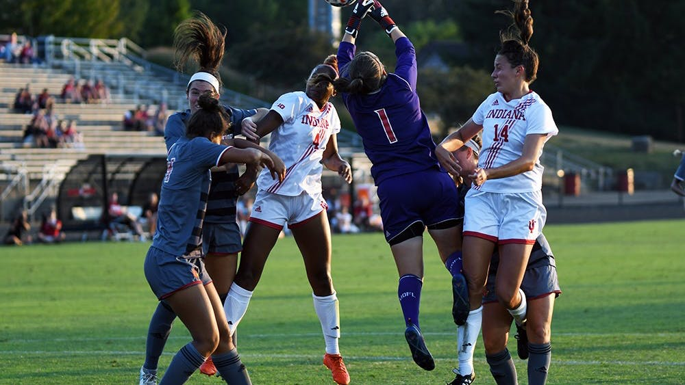 Junior forward Mykayla Brown (4) and sophomore midfielder Allison Jorden (14) fight for a header during IU's 2-0 loss to Louisville in August. Jorden was one of 18 Big Ten players who earned a 4.0 GPA.