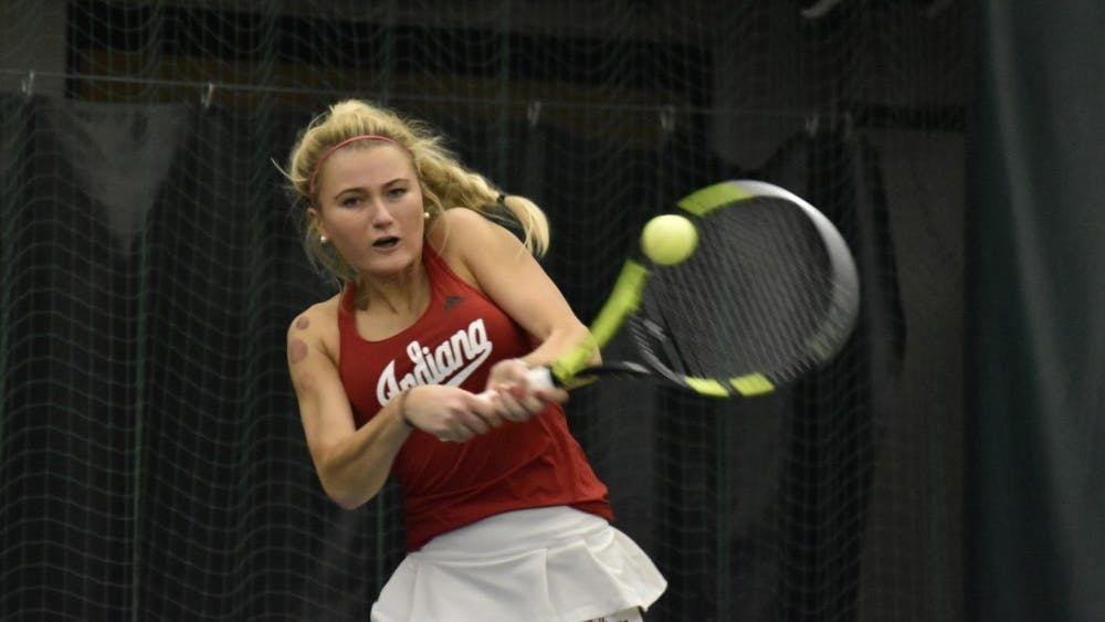 Junior Madison Appel swings through a backhand during her 7-5, 3-6, 7-5 singles win over the University of Tennessee. Appel and the Hoosiers go on the road for the first time this season to take on Notre Dame.