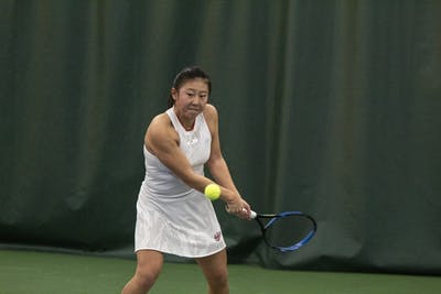 "Freshman Xiawei ""Rose"" Hu prepares to strike the ball Feb. 2 in the IU Tennis Center. IU will travel Feb. 15 to West Point, New York, to take on Cornell University."