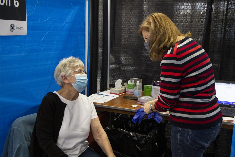 <p>IU Health nurse Anne Fuson prepares to give patient Iva Gloss the second dose of the Moderna COVID-19 vaccine Feb. 24 at the Monroe County Convention Center. Indiana announced Tuesday that people with chronic illnesses and developmental and intellectual disabilities are now eligible to receive the COVID-19 vaccine. </p>