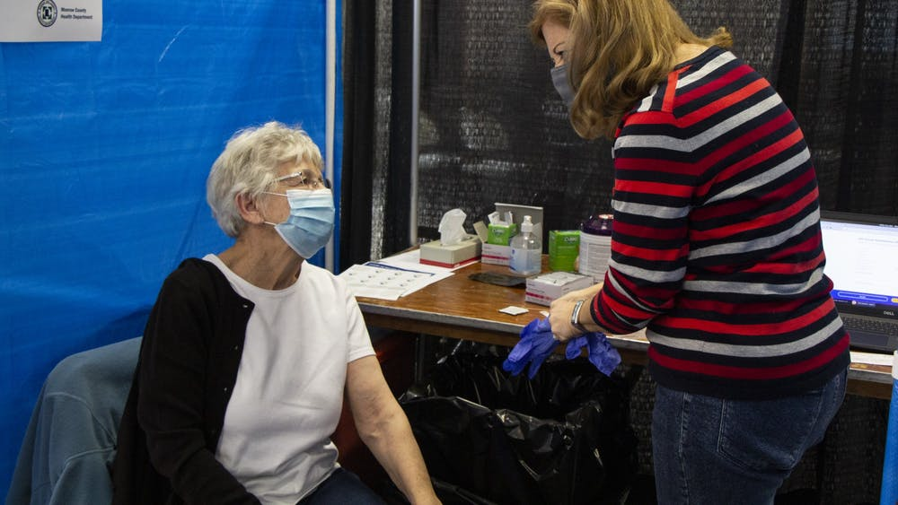 IU Health nurse Anne Fuson prepares to give patient Iva Gloss the second dose of the Moderna COVID-19 vaccine Feb. 24 at the Monroe County Convention Center. Indiana announced Tuesday that people with chronic illnesses and developmental and intellectual disabilities are now eligible to receive the COVID-19 vaccine.