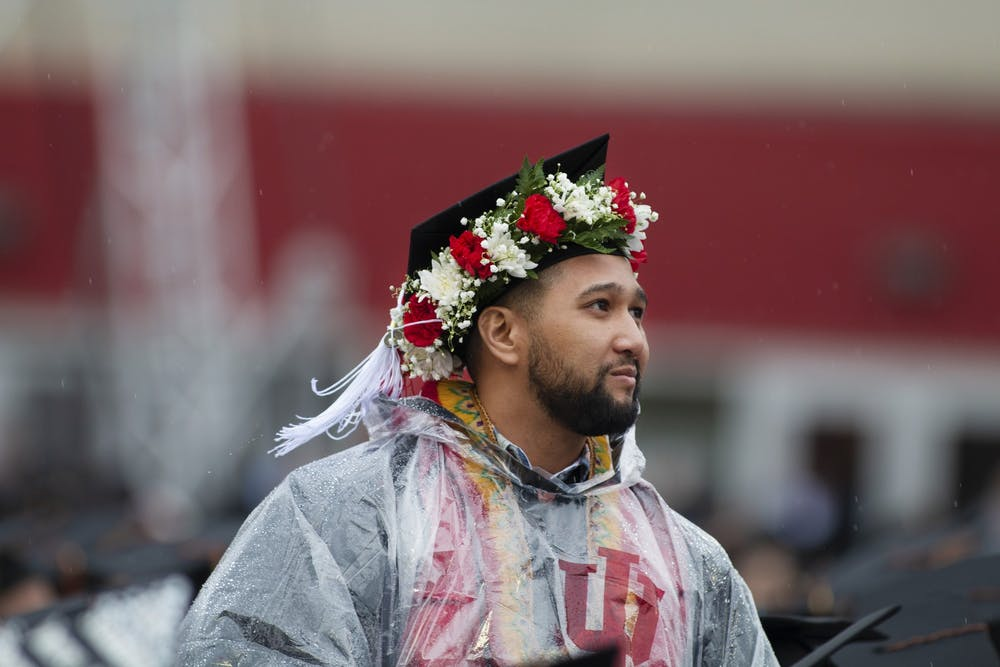 <p>An IU graduate stands with other active military members and veterans who attend IU on May 4, 2019, during the graduation ceremony at Memorial Stadium. IU postponed all 2020 spring commencement ceremonies, according to a statement released Friday.</p>
