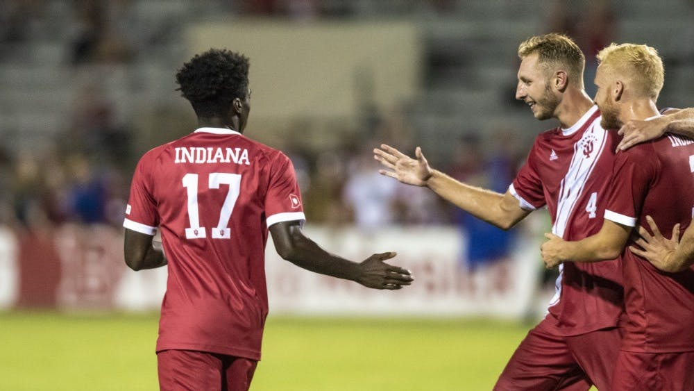 Senior Simon Waever, right, and redshirt junior A.J. Palazzolo, center, celebrate freshman Herbert Endeley's, left, equalizing goal against the University of Notre Dame on Sept. 17 at Bill Armstrong Stadium. IU beat Northwestern on Tuesday night 3-1.