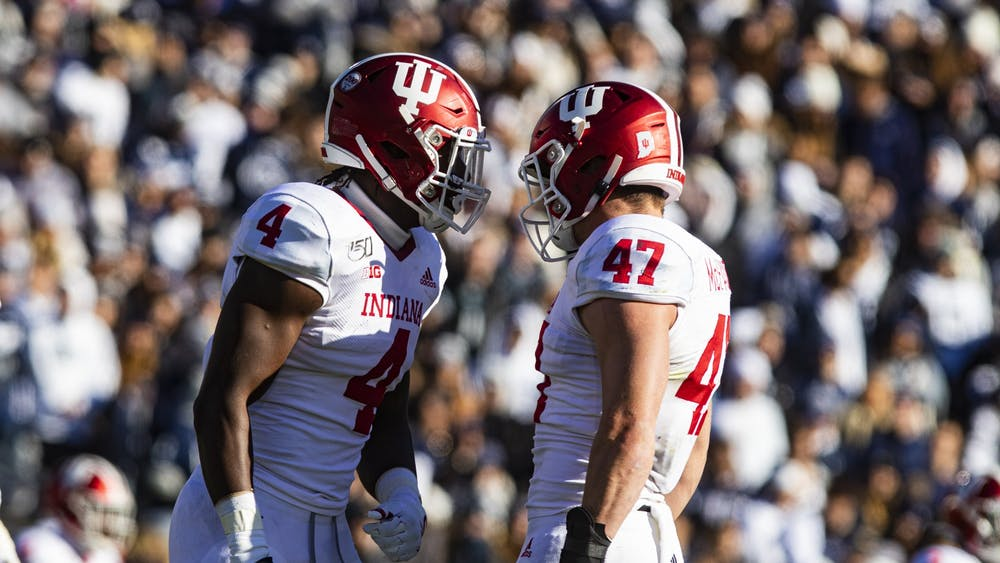 Then-sophomore linebacker Cam Jones and then-sophomore linebacker Micah McFadden prepare to bump helmets Nov. 16, 2019, at Beaver Stadium in State College, Pennsylvania. IU will play No. 9 Penn State at 3:30 p.m. Oct. 24 at Memorial Stadium, though no fans will be in attendance.