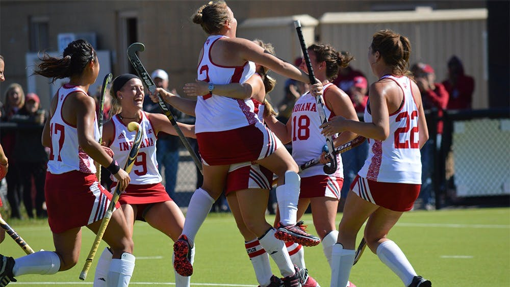 The IU field hockey team celebrates after a goal during the game against Penn State Sunday afternoon at the IU Field Hockey Complex. The Hoosiers defeated the Nittany Lions 1-0.