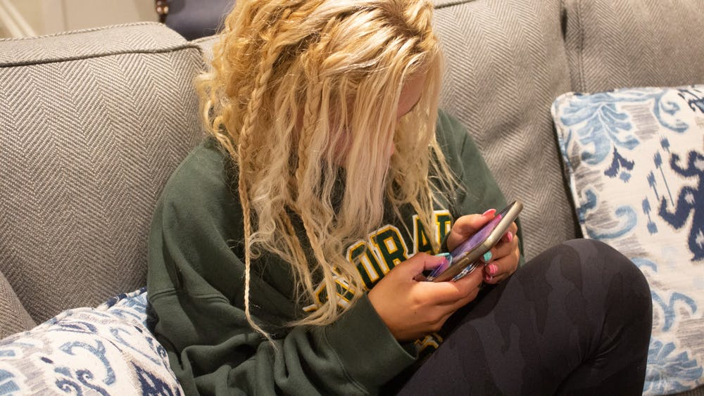 A woman looking at her phone Sept. 7, 2021. Misinformation can spread quickly on social media.