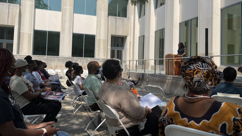 Attendees listen to speakers at the Coming Back Home event Sept. 12, 2021, in the parking lot at the Neal Marshall Black Culture Center. The Neal-Marshall Black Culture Center aims to represent community and togetherness, according to their website.
