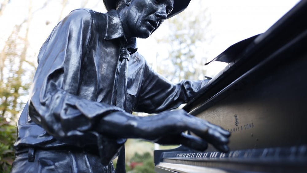 The Hoagy Carmichael statue plays the piano outside of the IU Auditorium. Community radio station WFHB will celebrate Carmichael's birthday with a fundraising event Nov. 16 at the Fountain Square Ballroom to honor the Bloomington-born musician.