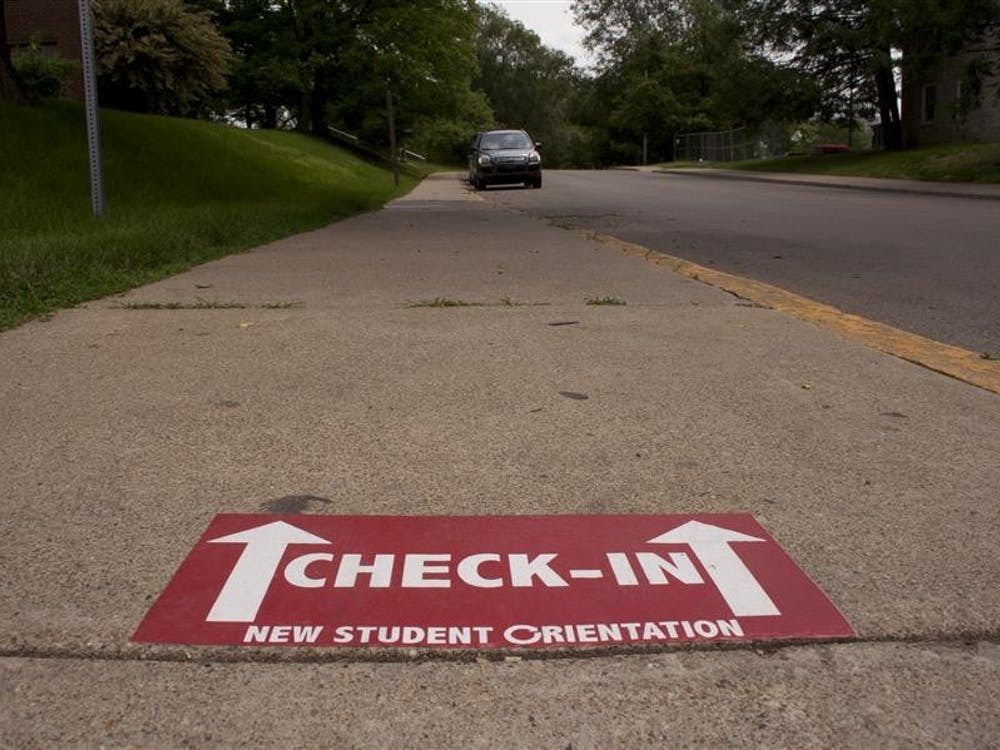 A sidewalk sign on East Seventh Street directs new students through the IU campus during Orientation.
