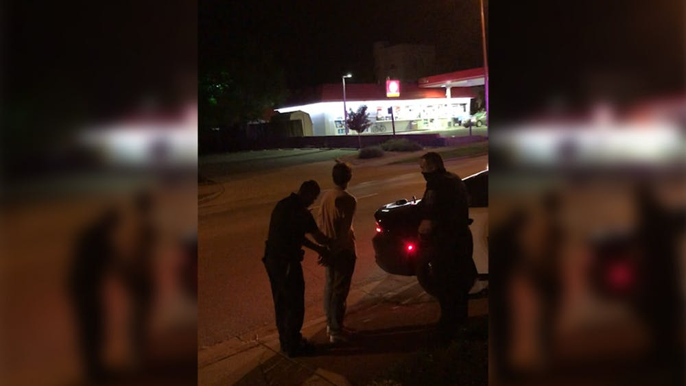 Bloomington Police Department officers are seen arresting a citizen Aug. 21 while not wearing face coverings. BPD defended its decision to not mandate face coverings despite the coronavirus pandemic and statewide mask mandate.