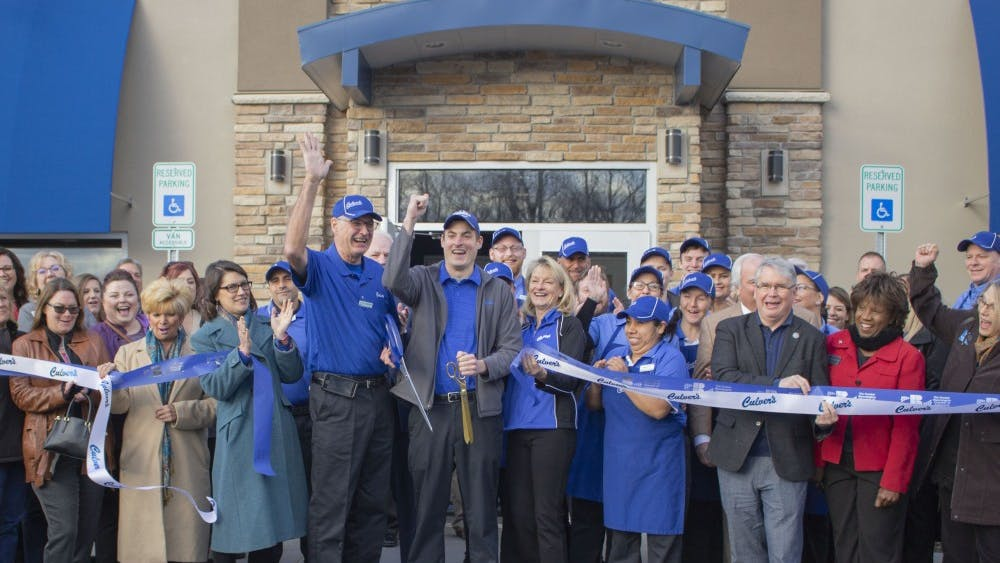 Owner and operator John Laskowski and general manager Scott Laskowski cut the ribbons in front of the new Bloomington Culver's on Wednesday morning. Guests who attended the event included Culver's employees, other Culver's owners, Mayor John Hamilton, and people from the Bloomington community.