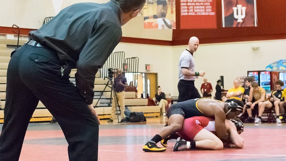 Duane Goldman coaches his son, senior Garrett Goldman, during a playoff meet against Appalacian State Sunday at the IU Gymnasium. IU lost to Appalacian State with a final score of 13-21.