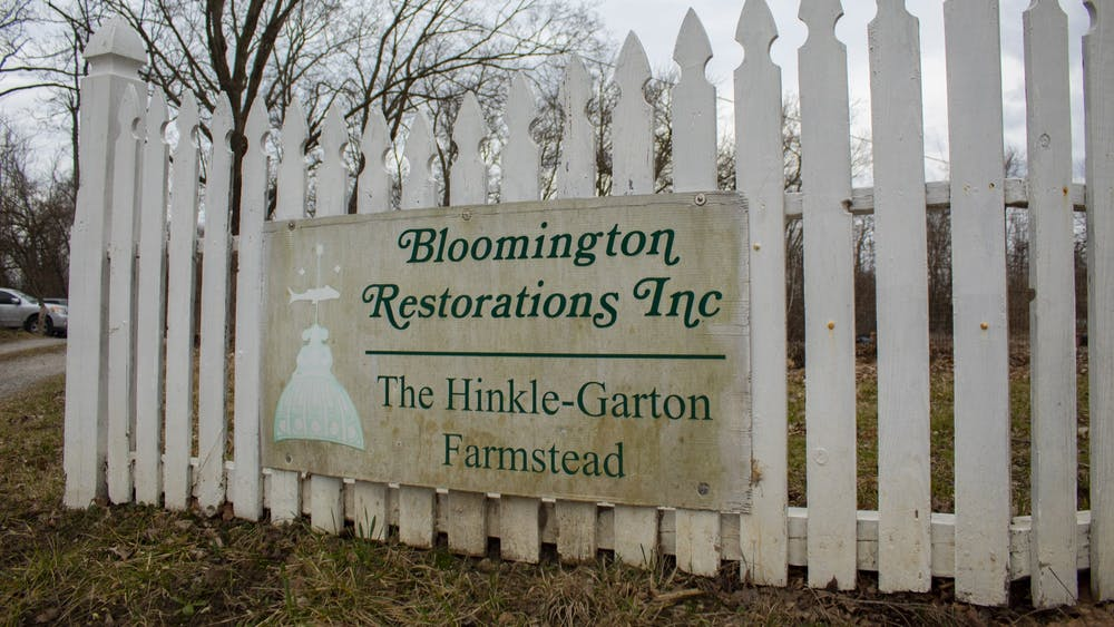 A sign for the Hinkle-Garton Farmstead hangs on a fence March 9 on 10th Street. The Hinkle-Garton Farmstead will allow visitors to explore its sugaring operations and purchase maple products from 10 a.m. to 4 p.m. March 14 in celebration of Indiana Maple Syrup Weekend.