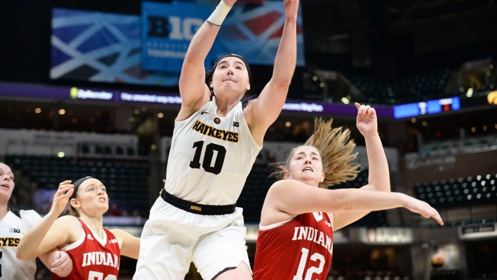 Iowa's Megan Gustafson rebounds the ball over sophomore forward Linsey Marchese during IU's third round Big Ten Tournament game against Iowa on March 8 in Bankers Life Fieldhouse. IU lost to Iowa, 70-61.