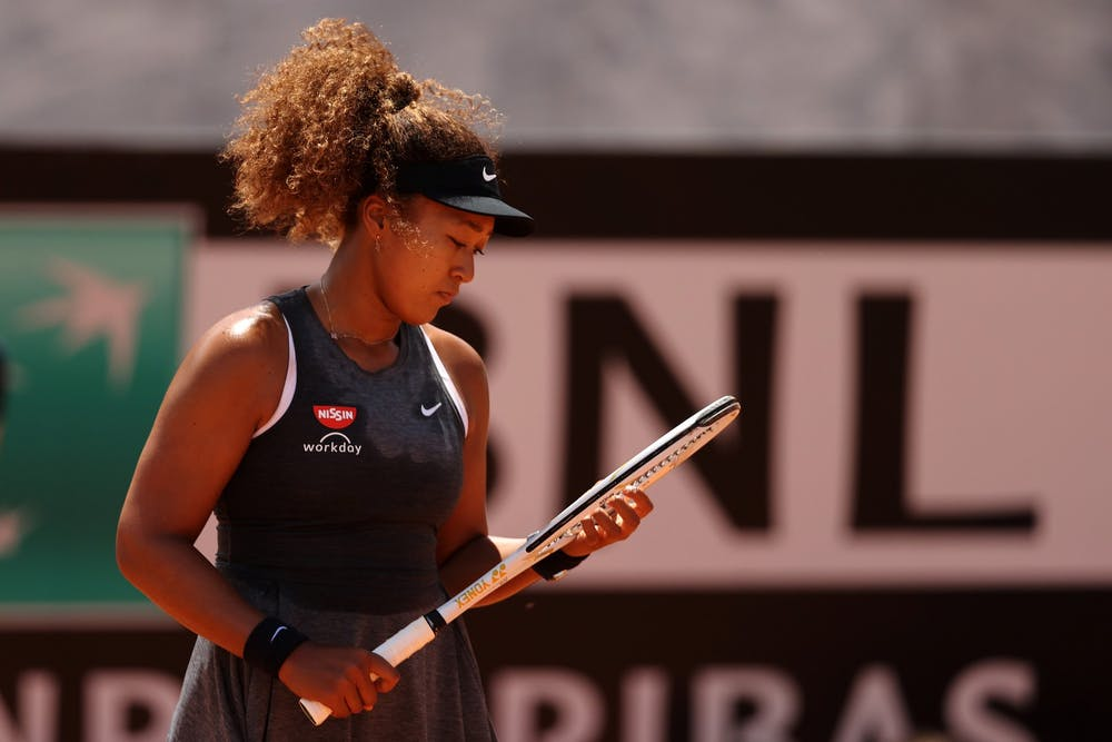 <p>Naomi Osaka looks at her racket May 12, 2021,  in Rome, Italy during the Internazionali BNL d&#x27;Italia match against Jessica Pegula of the United States.</p>