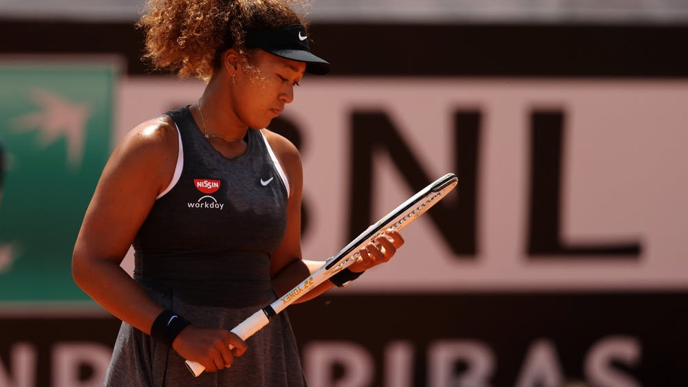 Naomi Osaka looks at her racket May 12, 2021,  in Rome, Italy during the Internazionali BNL d'Italia match against Jessica Pegula of the United States.