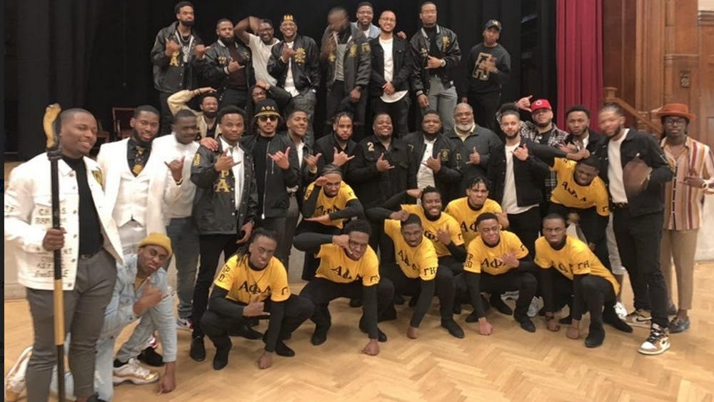 Members of the Alpha Phi Alpha fraternity pose for a photo at the spring 2020 probate in Alumni Hall.